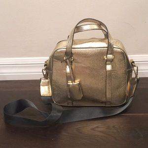Zara gold faux leather bag.